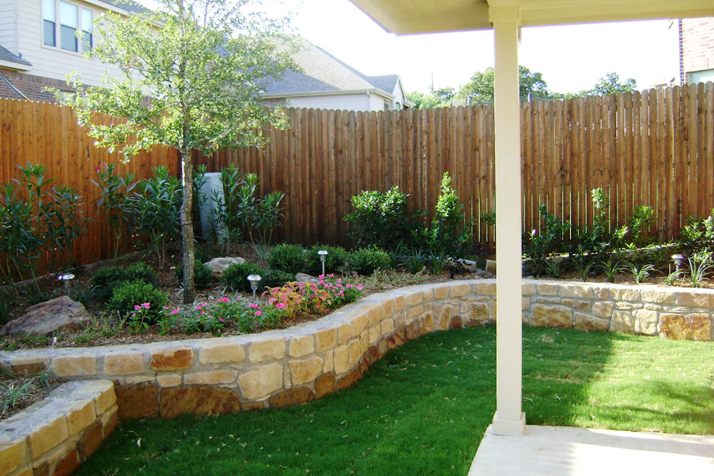 Landscape dallas landscape design abilene landscaping for Pics of landscaped backyards